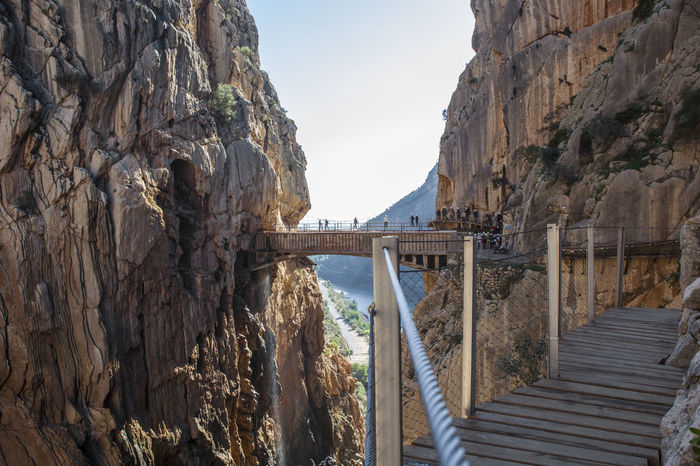 Visitors crossing the suspension bridge at Gaitanes Gorge, Malaga, Spain. Beauty In Nature Bridge - Man Made Structure Cityscape Day Nature No People Outdoors Scenics Sky Steep Travel Destinations Tree Water