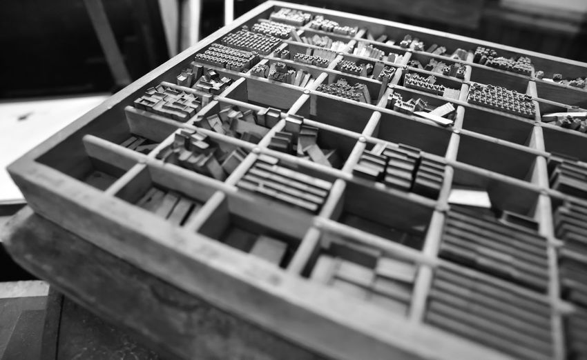 vintage graphic arts printing typeset Bradley Olson Bradleywarren Photography Backgrounds Background No People Room For Text Room For Copy Copy Space Copyspace Vintage Old Weathered Weathered Metal Weathered Wood Old-fashioned Antique Wood - Material Communication Selective Focus Table Close-up Indoors  Still Life Text Arts Culture And Entertainment Arrangement In A Row High Angle View Leisure Games Day Board Game Large Group Of Objects Game Box Order Typeset Graphic Design Printing Press Printing