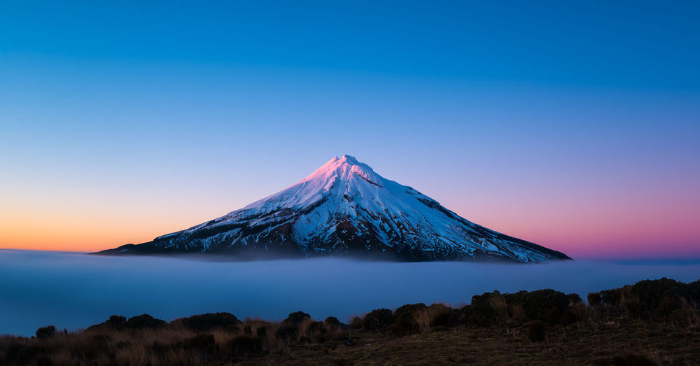 Beautifully incredible Mount Taranaki at sunrise Flow  Nature Scenic Travel Beauty In Nature Clear Sky Clouds Colorful Day Fog Idyllic Landscape Long Exposure Motion Mountain Movement New Zealand No People Outdoors Serene Sunrise Tranquil Scene