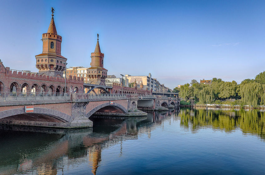 Oberbaumbrücke Arch Architecture Bridge - Man Made Structure Building Exterior Built Structure Clear Sky Connection Day History Nature No People Outdoors Place Of Worship Religion River Sky Spirituality Travel Destinations Water Waterfront