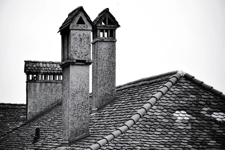 Chimneys Old Chimney Chimney Stacks Old Town EyeEm Gallery EyeEm Selects EyeEm Best Shots EyeEm Best Shots - Black + White Blackandwhite Black And White Black & White Monochrome monochrome photography Architectural Column Taking Pictures My Point Of View Taking Photos Light And Shadow Roof House Architecture Building Exterior Built Structure Roof Tile Rooftop TOWNSCAPE