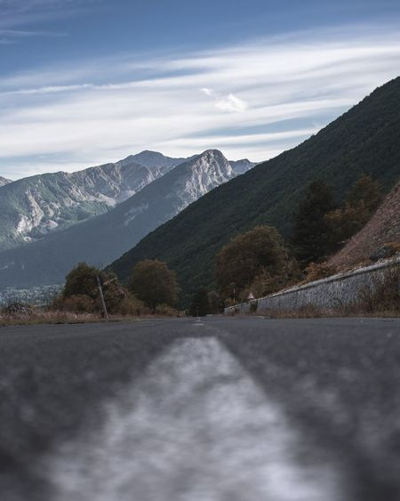 Road amidst mountains against sky