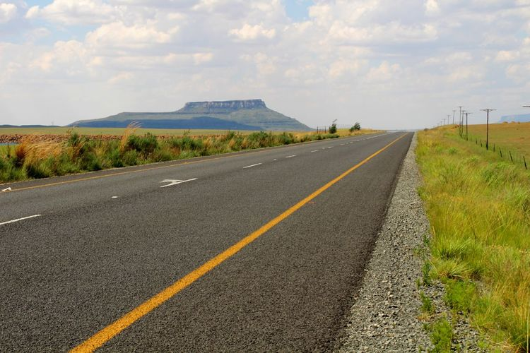 Africa Mountain Road Sky Grass Landscape Cloud - Sky Empty Road The Way Forward Treelined Double Yellow Line Winding Road Mountain Road vanishing point Road Marking Straight Diminishing Perspective Dividing Line Country Road Asphalt It's About The Journey