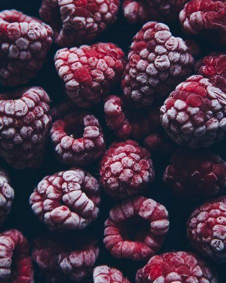 Full frame shot of frozen raspberries