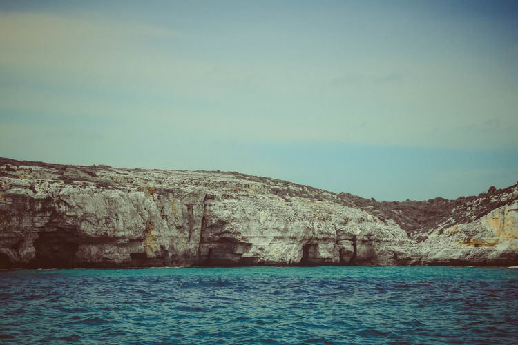 Water Sky Scenics - Nature Tranquility Nature Beauty In Nature Day Outdoors Rock Seacave Seascape View Into Land Sea Tranquil Scene Rock Formation Clear Sky Copy Space