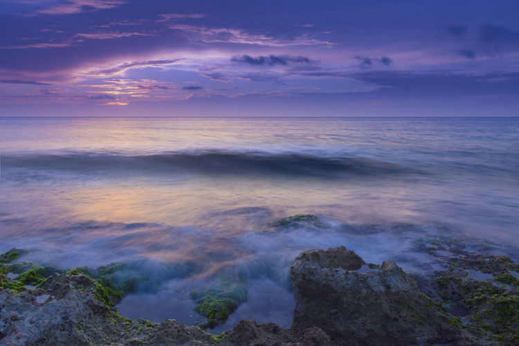 Rocky seascape Long Exposure Blue Hour Moody Sky Wave Water Sea Sunset Beauty Blue Tide Low Tide Coastal Feature Marram Grass Coastline Coast Calm Seascape Flowing Water Headland Rocky Coastline Rock Formation Rock Flowing Horizon Over Water Ocean Dramatic Sky