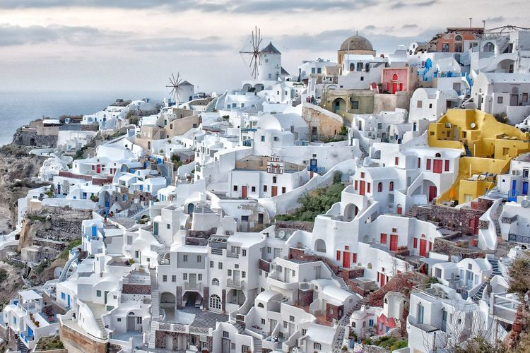 High angle view of townscape by sea against sky. oia, santorini