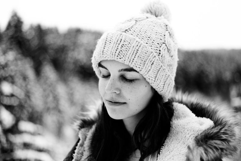 Close-up of young woman in knit hat