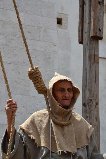 Portrait of senior man holding rope