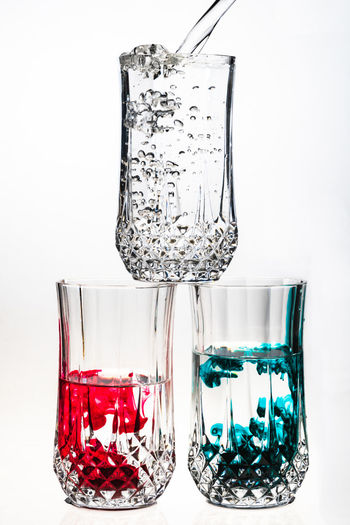 Bright field, food coloring Transparent Glass Glass - Material White Background Studio Shot Refreshment Drinking Glass No People Indoors  Food And Drink Close-up Drink Still Life Red Household Equipment Alcohol Freshness Container Water Red Wine Luxury
