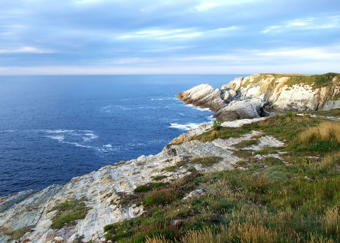 Scenic view of rocky coastline against cantabrian sea