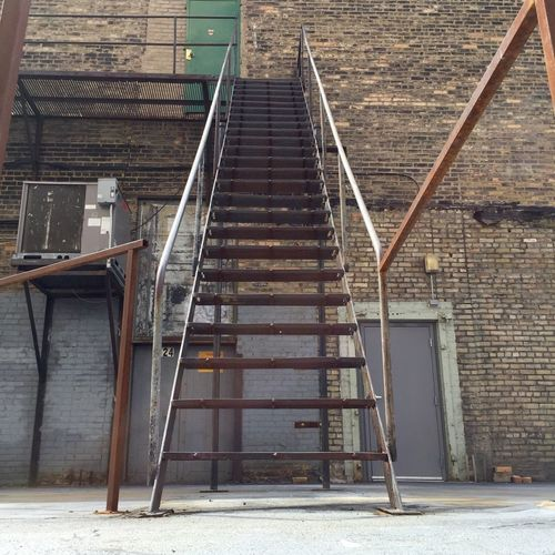 Steps Railing Wall - Building Feature Staircase Empty Metal Built Structure Steps And Staircases Architecture Outdoors Bad Condition Day Obsolete Narrow No People Handrail  The Way Forward Alley Alleyway Minnesotaphotographer Rusty Rust Handrail