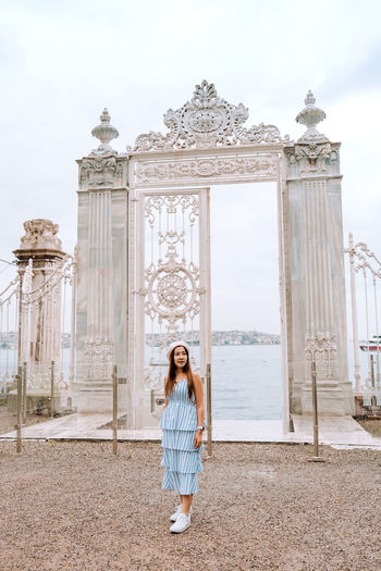Woman standing in front of historical building