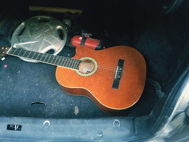 TakeoverMusic Guitar Music Guitar High Angle View Musical Instrument Musical Equipment Musical Instrument String Arts Culture And Entertainment Indoors  Accoustic Guitar Day No People Fretboard Car Back Car