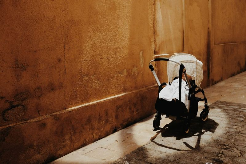 Baby Carriage In A Street