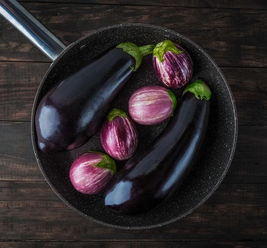 Whole eggplants on frying pan top view. Classic and Listada de Gandia varieties. Top view. Eggplant Listada De Gandia Close-up Day Eggplants Food Food And Drink Freshness Healthy Eating Indoors  No People Top View Varieties Vegetable