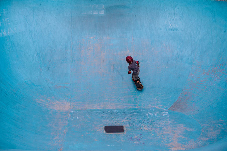 High Angle View Of Boy Skateboarding At Park