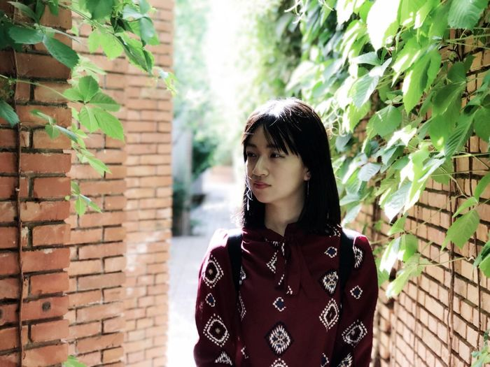 EyeEm Best Shots Architecture Red Brick Wall ThatsMe One Woman Only My Unique Style The Portraitist - 2017 EyeEm Awards Portrait Portrait Of A Woman One Person Outdoors Girl Asian Girl Black Hair Beauty In Nature