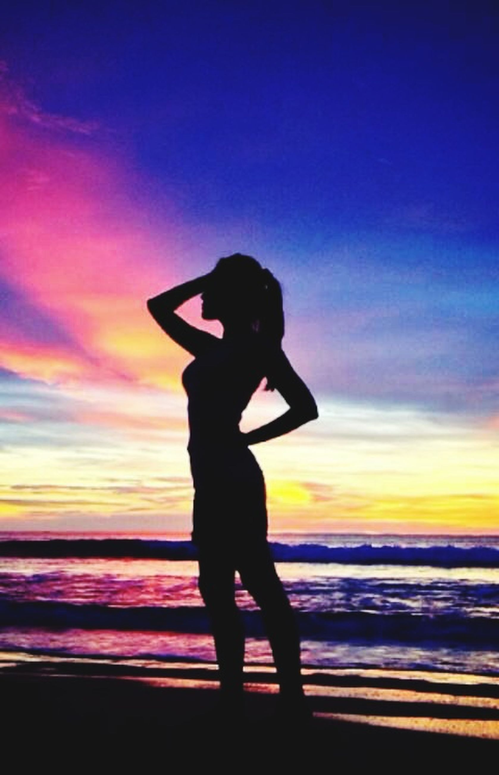 sunset, silhouette, sky, standing, lifestyles, leisure activity, full length, cloud - sky, orange color, sea, beach, dusk, outdoors, horizon over water, side view, three quarter length, water, nature
