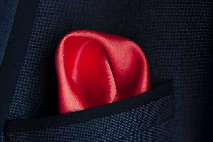 Close up of red handkerchief in pocket