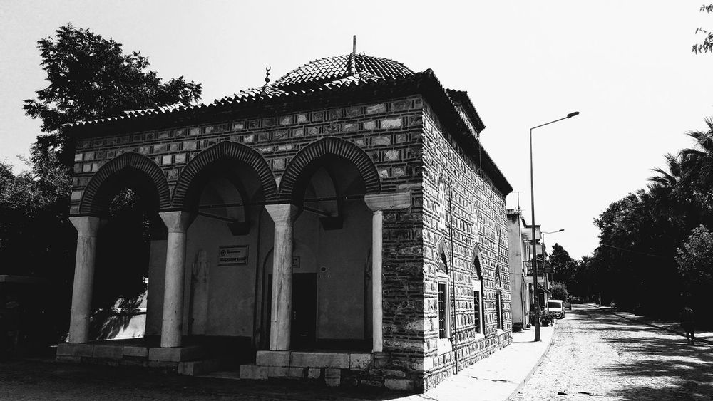 Architecture Built Structure History Outdoors Building Exterior Day Architectural Column No People Low Angle View Sky Black And White Mosque Architecture Mosque Turkey Mosque Photography Old Mosque Black And White Friday Arch Tree Clear Sky EyeEm Ready   EyeEm Ready