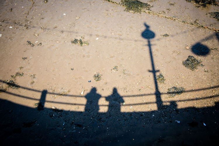 Shadows Whitby Yorkshire City Day Focus On Shadow Footpath High Angle View Leisure Activity Lifestyles Nature Outdoors People Real People Road Shadow Street Sunlight Transportation Two People Women