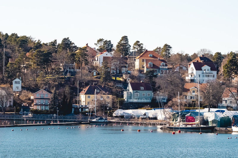 Houses by the shore in the suburb bromma in stockholm, sweden