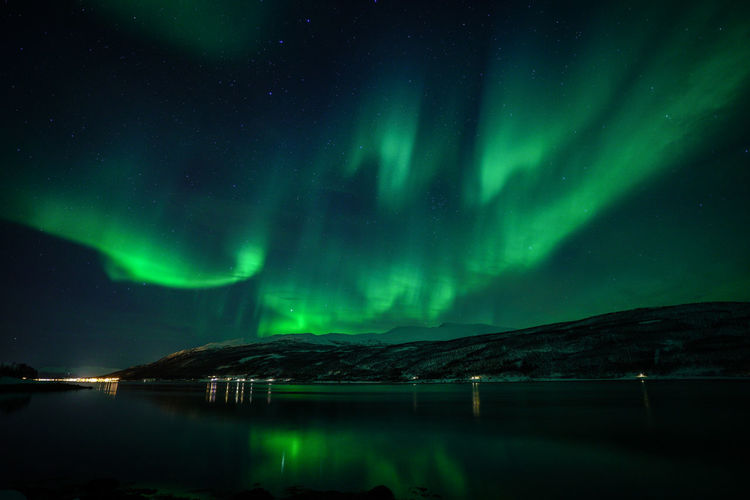 Aurora Borealis Northern Lights Norway Travel Photography Tromsø Winter Astronomy Aurora Polaris Beauty In Nature Cold Temperature Galaxy Green Color Illuminated Lake Mountain Natural Phenomenon Nature Night No People Outdoors Polar Night Scenics Sky Snow Star - Space Svalbard  Tranquil Scene Tranquility Travel Destinations Water Waterfront Winter