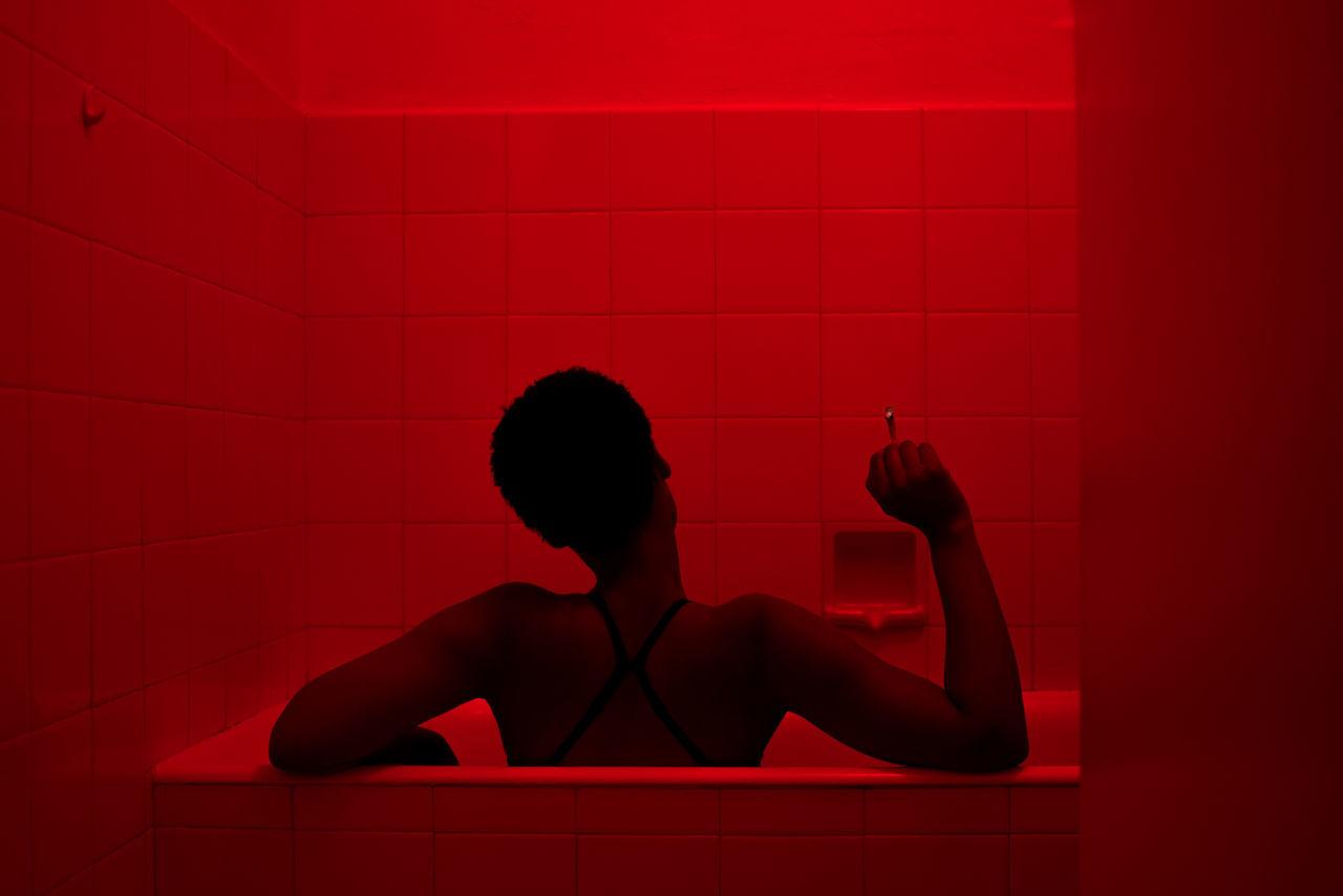 Rear view of woman in bathtub