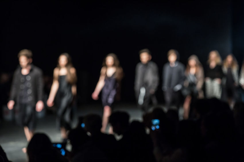 Fashion Show Themed Photos Backlit Blurred Catwalk Catwalk Event Clothes Designer Clothes Event Fashion Fashion Background Fashion Industry Fashion Models Fashion Show Fashion Show Background Fashionable Finale Haute Couture Lifestyles Runway Runway Show Show Finale Sillhouette Stylish Unrecognizable Unrecognizable People Walking