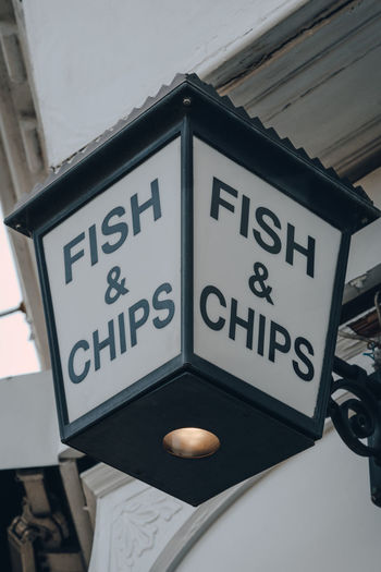 Close up of fish and chip sign outside a restaurant in london, uk, selective focus.