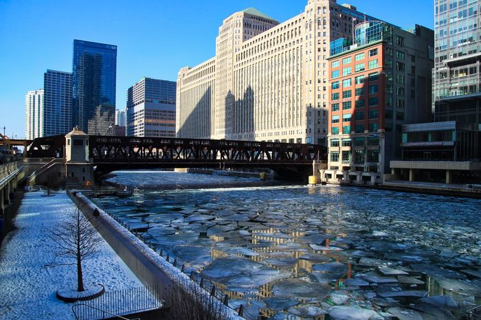 View of riverwalk and frozen river with chunks of ice and reflections in water in Chicago downtown loop. Waysofseeing Tree Snow-covered Footprints In The Snow Chicago Loop Chicago Chicago River Chicago Riverwalk Chicago El Downtown Chicago Elevated Track Frozen Ice January Reflection Tree Winter Architecture Bridge - Man Made Structure Bridgehouse Building Exterior Built Structure City Cracked Ice Drawbridge  Frozen River Ice Chunks Outdoors Snow Water
