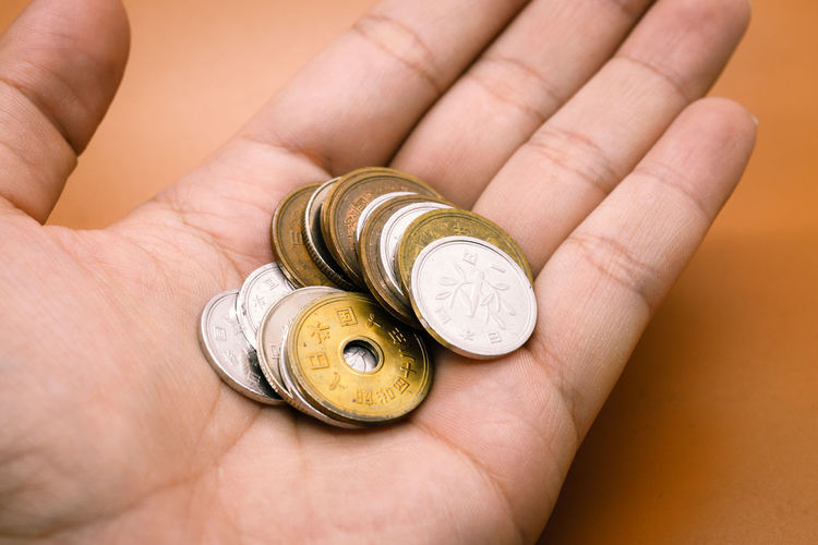 Money. Japanese  Yen Money Body Part Coin Finger Gold Colored Hand Human Finger Human Hand One Person