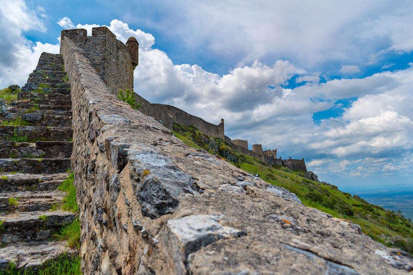 Castelo de Marvão Ancient Architecture Beauty In Nature Built Structure Cloud - Sky Day Environment History Land Low Angle View Mountain Nature No People Outdoors Rock Ruined Scenics - Nature Sky Solid Stone Wall The Past Tranquil Scene Travel