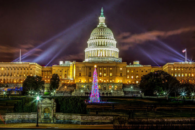 Christmas at the capitol building Christmas Lights Floodlights US Capitol Building Architectural Column Architecture Building Exterior Built Structure christmas tree City Cloud - Sky Dome Fountain Government Illuminated Nature Neo-classical Night No People Sky Spotlights The Past Tourism Travel Travel Destinations