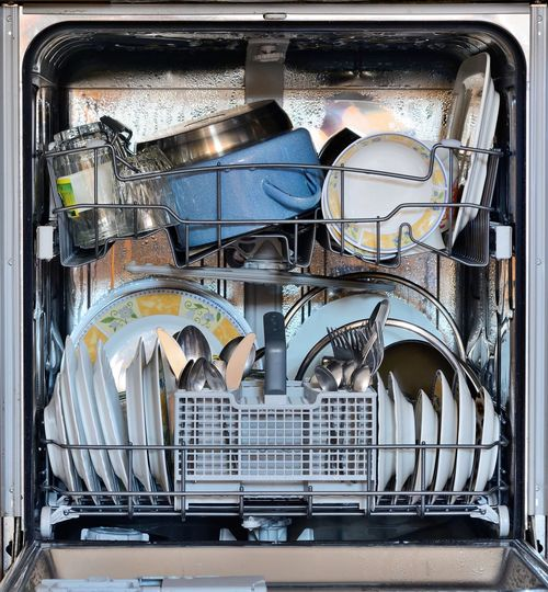 Utensils in dishwasher at home