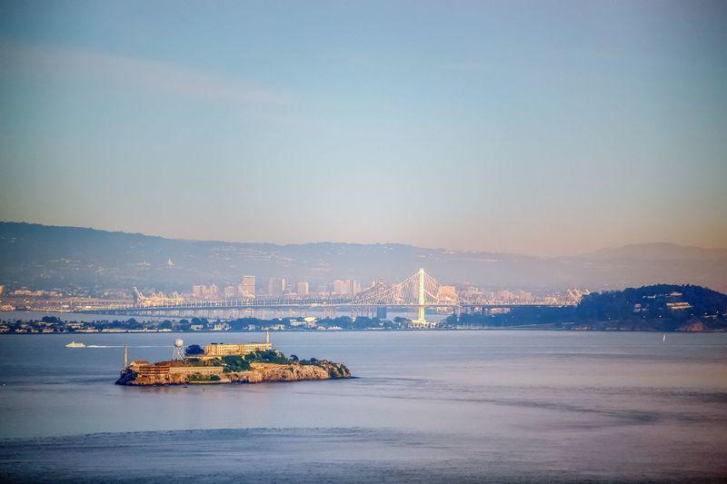 Alcatraz Island And Bridge Against Sky