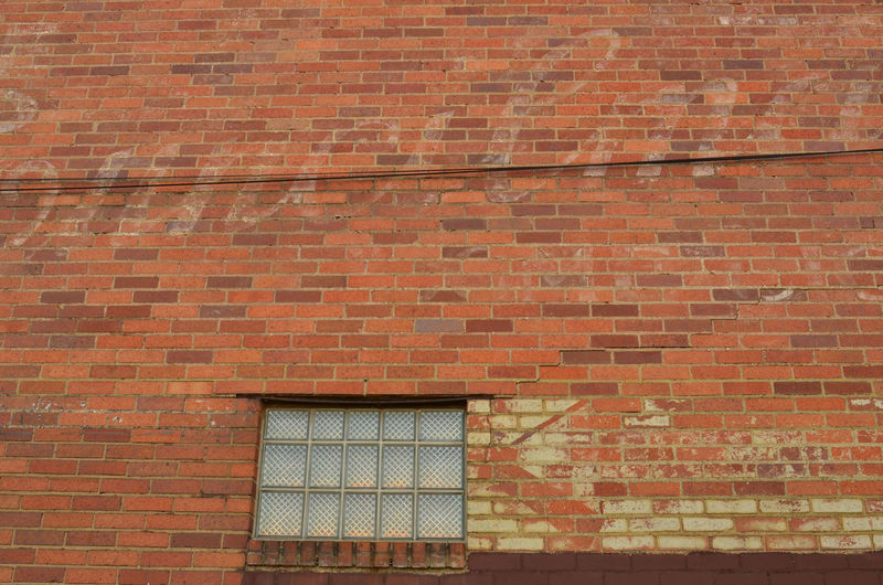 ghost sign vintage faded hand-painted sign lettering on red brick wall Architecture Brick Wall Brick Wall Building Exterior Built Structure Day Ghost Sign Ghost Signs  No People Outdoors Urbex Vintage Advertising Vintage Style