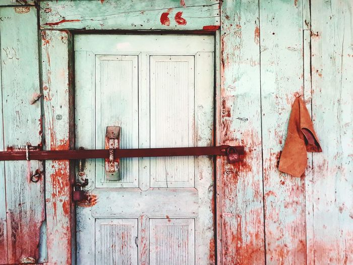 Closed Door Of Old Abandoned House