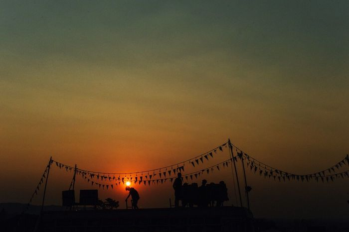 Sunset Large Group Of People Real People Silhouette Sky Leisure Activity Sea Men Vacations Outdoors Amusement Park Nature Beauty In Nature Crowd People Adult Day Wonderfruit