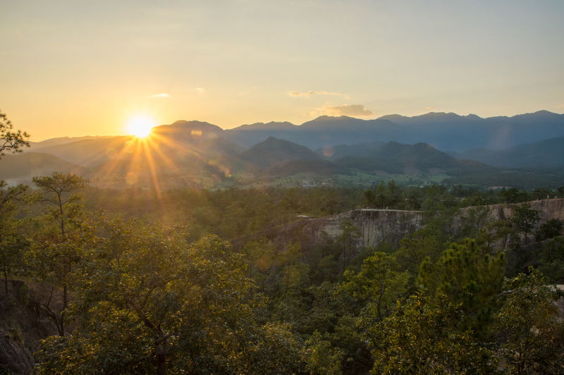 Sunset in Pai canyon Beauty In Nature Sky Scenics - Nature Tranquility Tranquil Scene Mountain Plant Sunset Sun Tree Lens Flare Sunlight Sunbeam Non-urban Scene Nature No People Mountain Range Environment Landscape Idyllic Outdoors