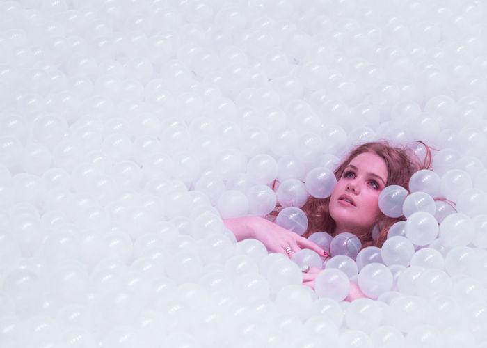 Portrait of a girl lying on floor