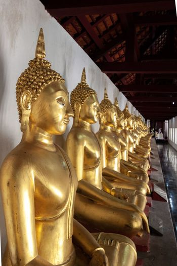 Gold statues of