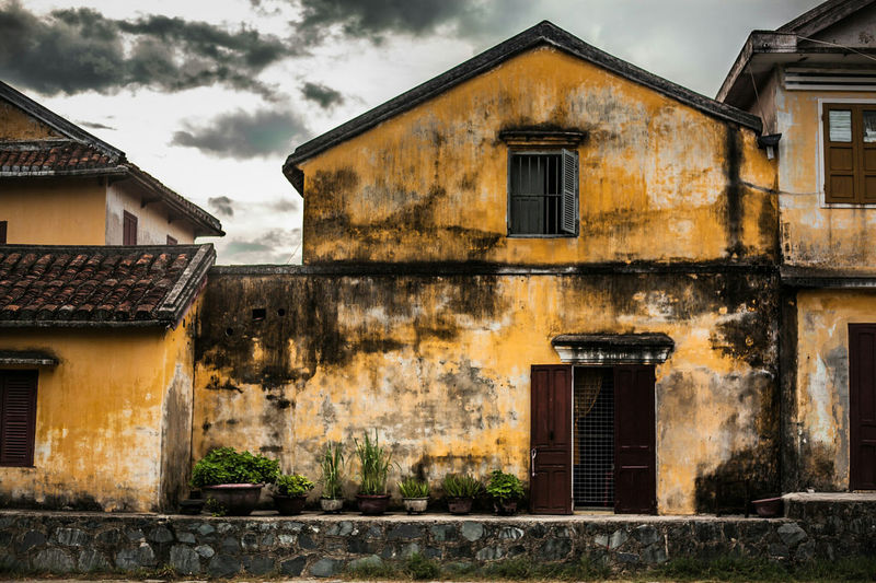 A little weathered. Hoi An, Vietnam. Built Structure Architecture Building Exterior House Old Buildings Old Town Run Down Building South East Asia Hoi An Travel Destinations Hoi An, Vietnam WeekOnEyeEm Eye4photography  EyeEm Gallery Check This Out EyeEm Best Shots Exceptional Photographs Bestoftheday First Eyeem Photo Malephotographerofthemonth Vietnam Central Vietnam Travel Photography Cityscape Doors Lover