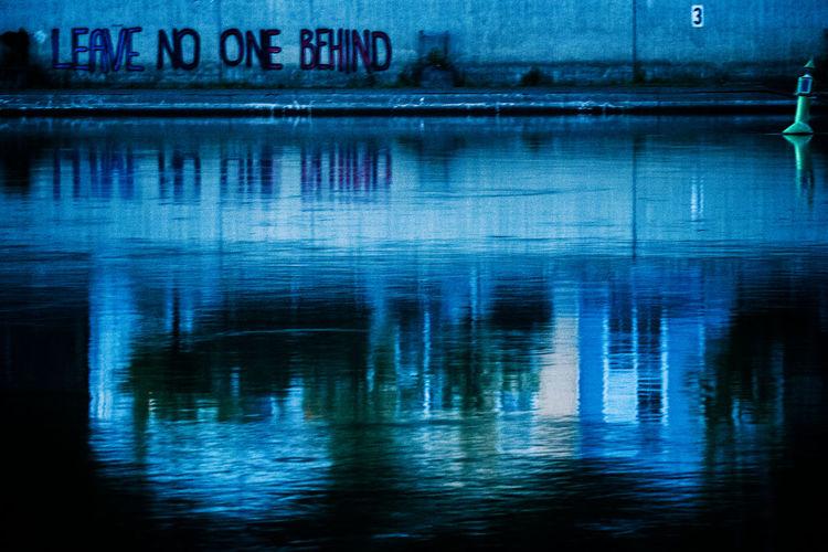 Reflection of illuminated water in lake at night