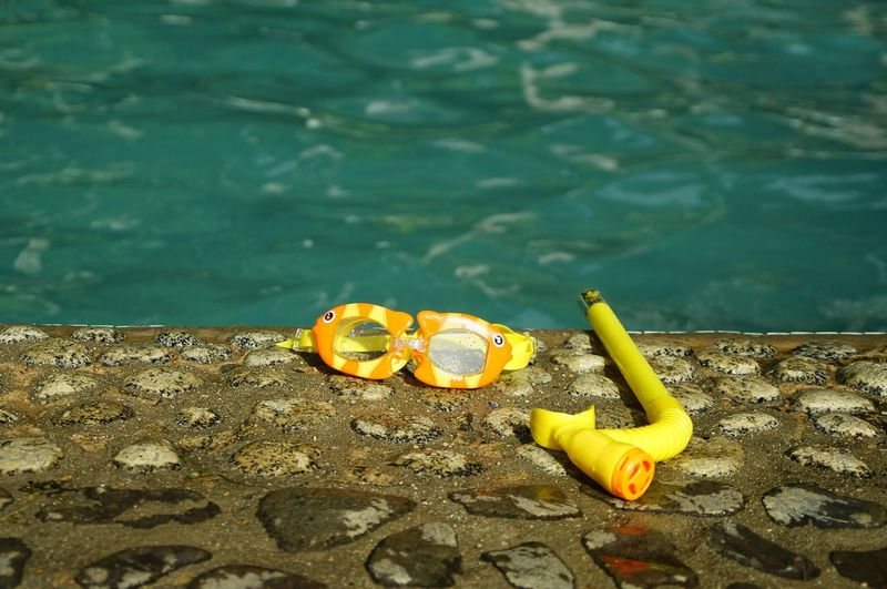 High angle view of yellow toy floating on lake