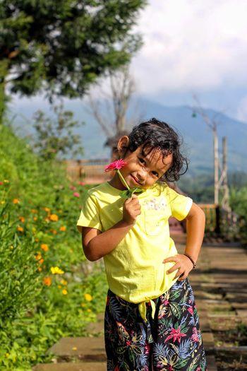 Girl holding flower in the park