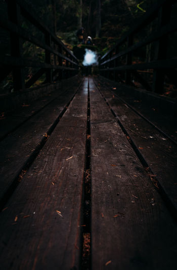 The Way Forward No People Wood Nature Railing Metal Transportation Diminishing Perspective Wood - Material Direction Rail Transportation Railroad Track vanishing point Outdoors Day Track Footpath Connection Bridge Tree Surface Level Long