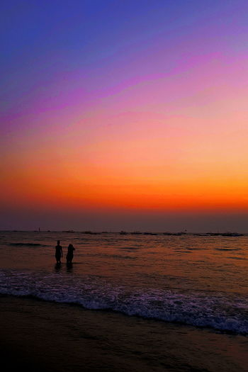 Perspectives On Nature Beach Beauty In Nature Horizon Over Water Leisure Activity Nature Orange Color Outdoors Real People Sand Scenics Sea Shore Silhouette Sky Sunset Togetherness Two People Vacations Water Wave