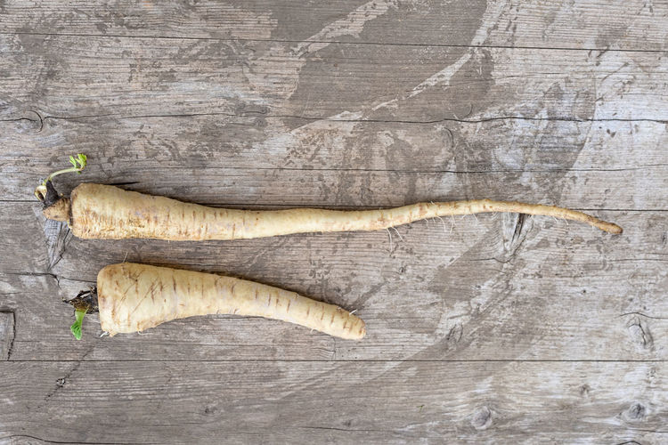 Close-Up High Angle View Of Radish On Wooden Table